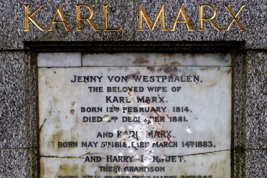 A memorial to German philosopher Karl Marx is seen after it was vandalised at Highgate Cemetery in London.