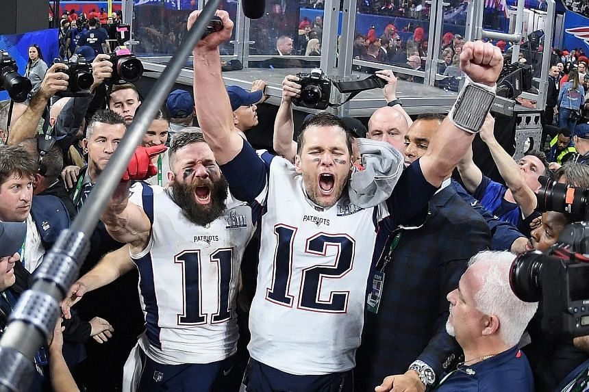 Above: New England Patriots' Sony Michel scoring their first touchdown. Left: Most Valuable Player Julian Edelman, (No. 11) and Patriots teammate Tom Brady celebrating at the end of Super Bowl LIII at the Mercedes-Benz Stadium on Sunday after they be