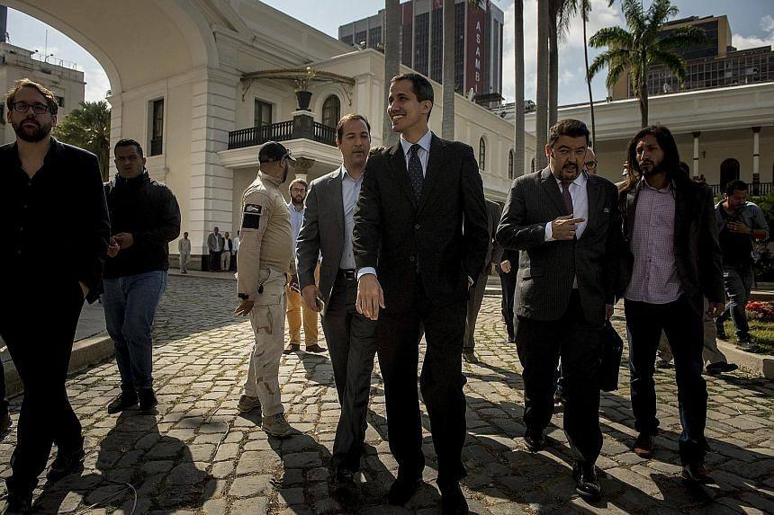 Venezuelan opposition leader Juan Guaido (centre) arriving for a session of the National Assembly, in Caracas, on Jan 29. The young lawmaker sees a clear, if daunting, path to ousting President Nicolas Maduro.