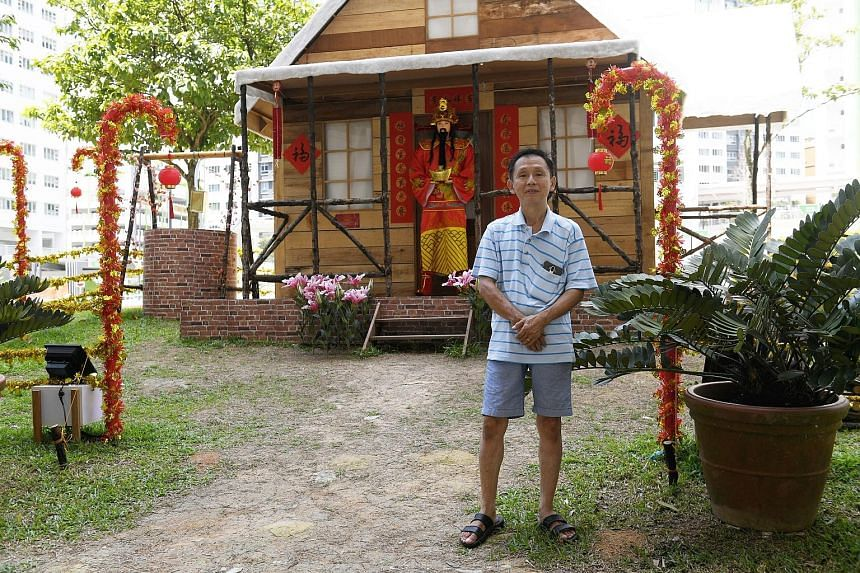 """It was a Christmas cabin but with the help of Woodlands Housing Board residents, it has been transformed for Chinese New Year. The """"snow-topped"""" log cabin in front of Block 178 Woodlands Street 13 now sports decorations such as Chinese couplets, the"""