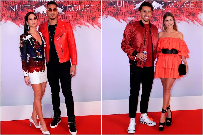 Paris Saint-Germain's French goalkeeper Alphonse Areola poses with his wife Marion (left) and defender Marquinhos (left) with a guest, arrive at Neymar's birthday party.
