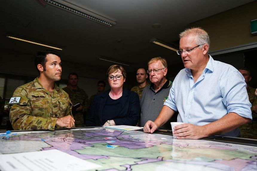 Australian Prime Minister Scott Morrison (right) visiting flood affected areas in Townsville, Australia, on Feb 5, 2019.