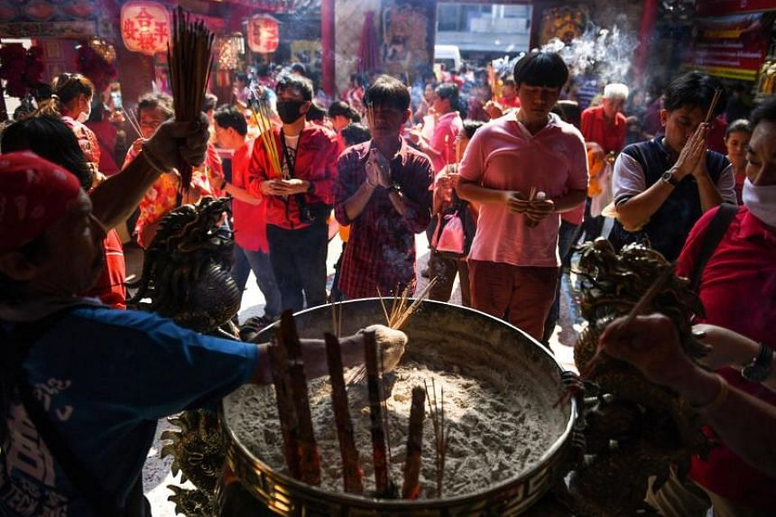 People praying in a Chinese temple during Chinese New Year celebrations in Bangkok on Feb 5, 2019.