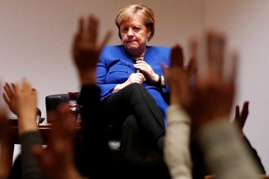 """Speaking at Keio University in Tokyo, German Chancellor Angela Merkel said there was a """"big debate"""" in Germany about using Huawei equipment."""