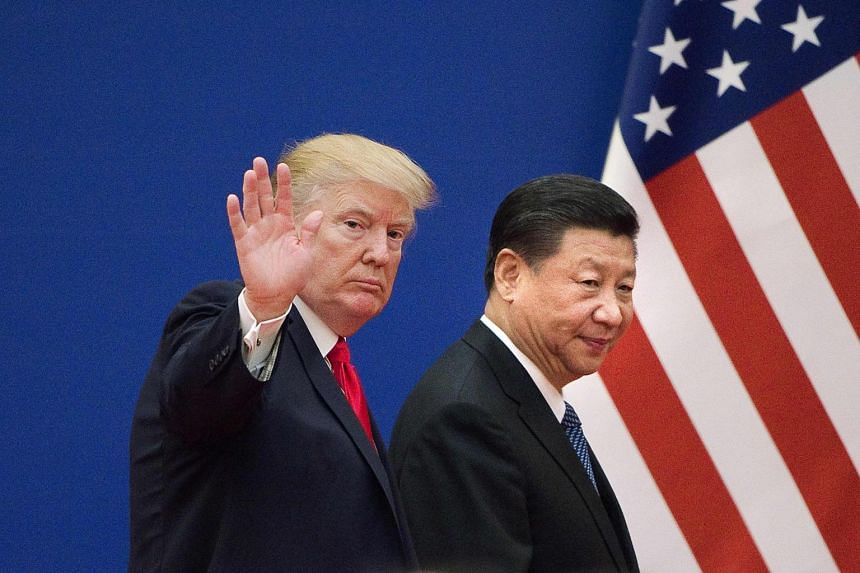 US President Donald Trump (left) and China's President Xi Jinping leaving a business leaders event at the Great Hall of the People in Beijing, on Nov 9, 2017.