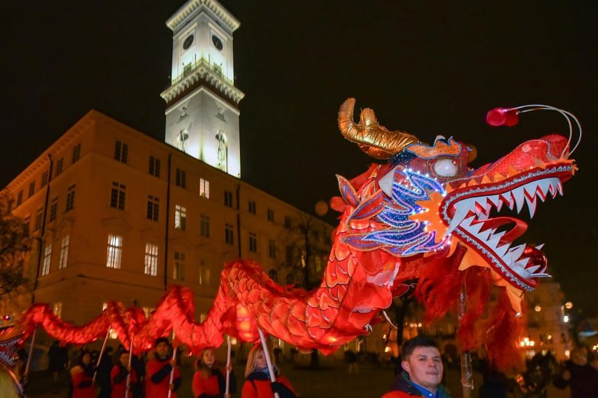 People performing as they celebrate the Chinese New Year in downtown Lviv, Ukraine, on Feb 4, 2019.