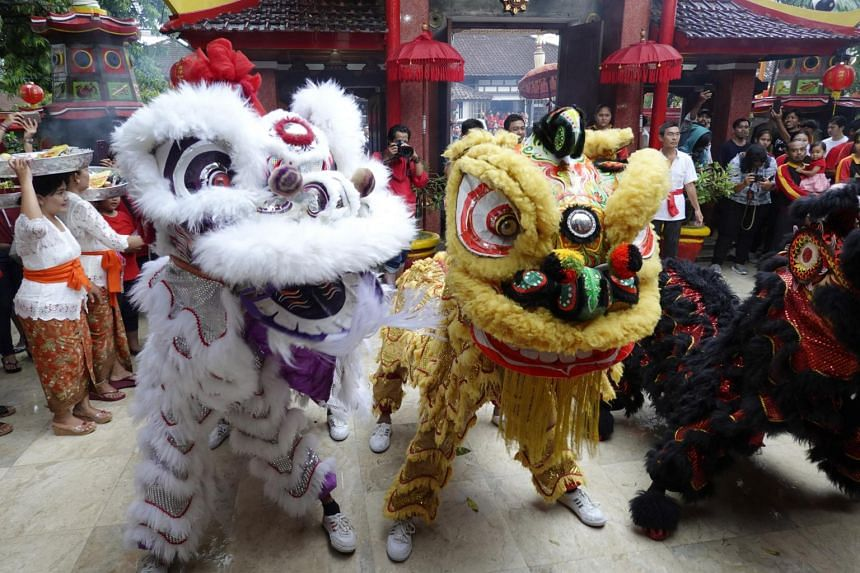 A group of dancers perform 'Liong', or dragon dance, during Chinese New Year celebrations at a temple in Kuta, Bali, Indonesia.