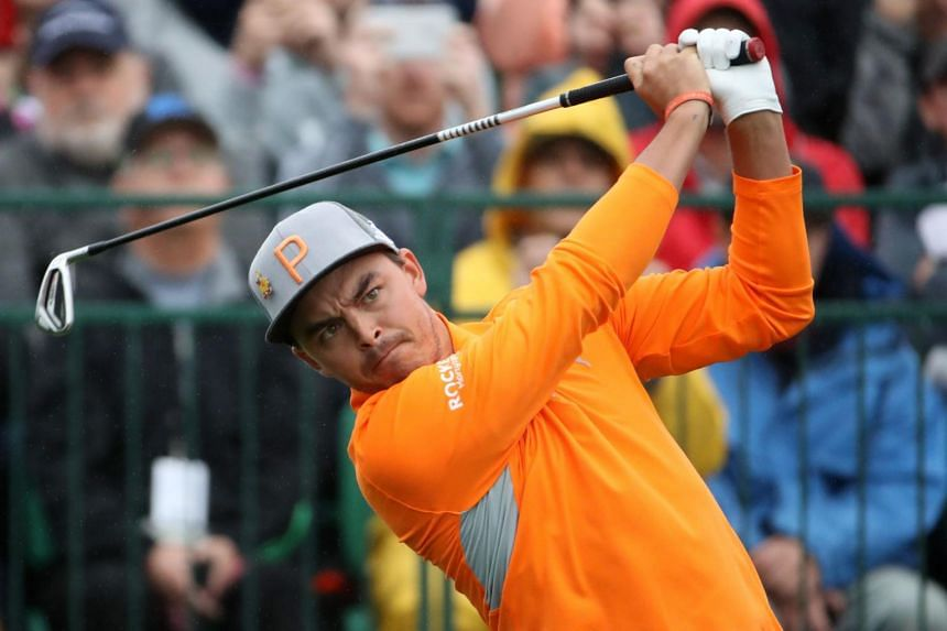 Rickie Fowler plays his shot from the first tee during the final round of the Waste Management Phoenix Open.