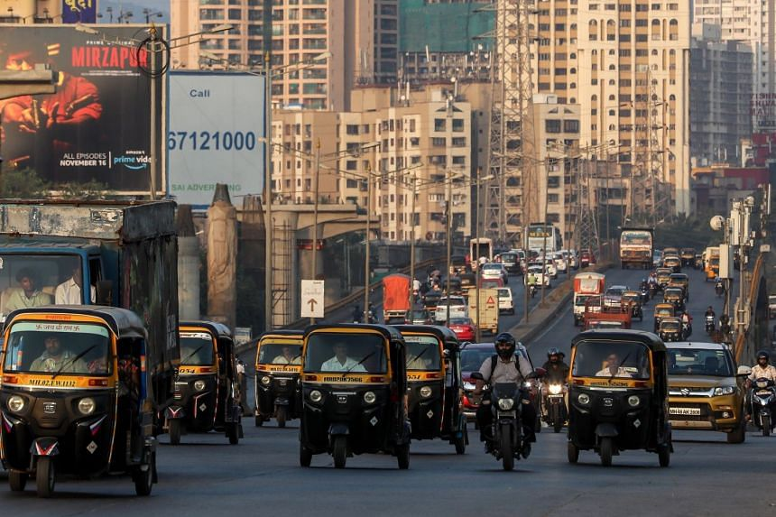 Vehicles drive along the western express highway in Mumbai, India.