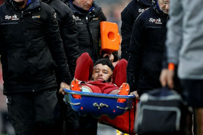 Liverpool's Alex Oxlade-Chamberlain is stretchered off after sustaining an injury in April 2018.