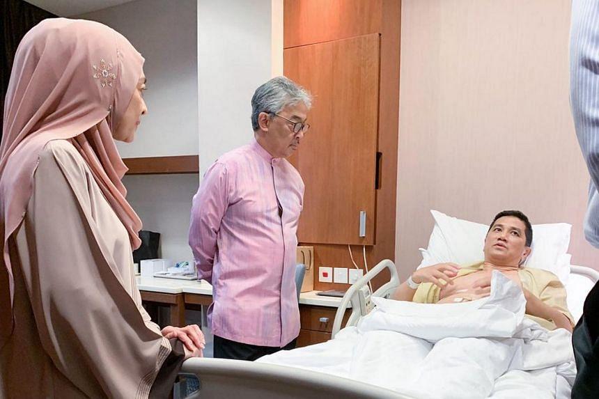 Malaysia's King, Sultan Abdullah Ri'ayatuddin Sultan Ahmad Shah, visits Malaysian Economic Affairs Minister Azmin Ali, while Datuk Seri Azmin's wife Shamsidar Taharin looks on, on Feb 5, 2019.