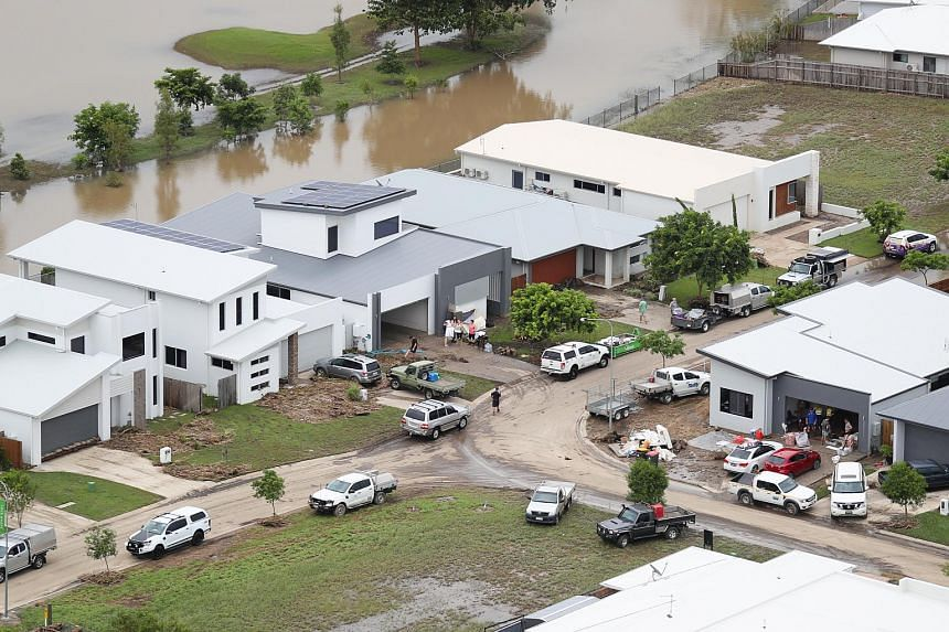 An aerial photo shows local residents cleaning up as flood waters ease in parts of Townsville, North Queensland, Australia on Feb 5, 2019.