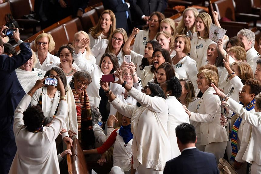 Congresswomen, dressed in white in tribute to the women's suffrage movement, pose for a photo as they arrive for the State of the Union address at the US Capitol in Washington, DC on Feb 5, 2019.