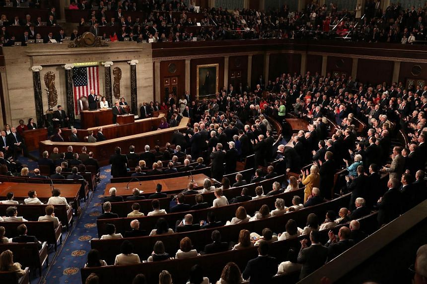 Republicans stand and applaud while Democrats remain in their seats as US President Donald Trump delivers his second State of the Union address on Feb 5, 2019.