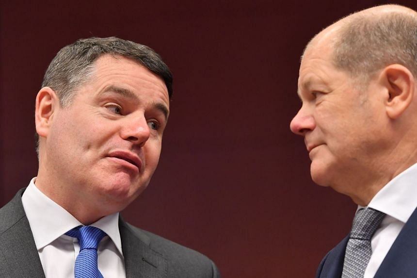 Donohoe (left) talking to Germany's Finance Minister Olaf Scholz during a Eurogroup meeting  in Brussels.