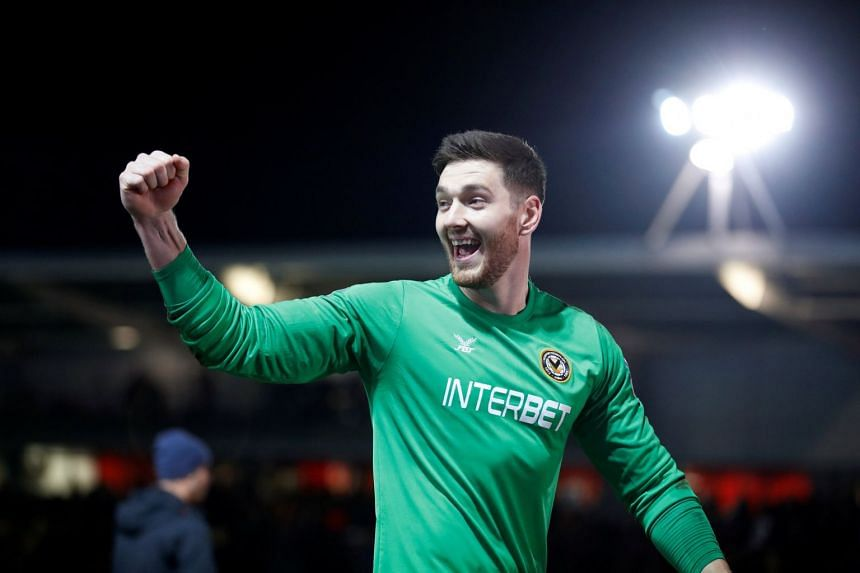 Newport County's Joe Day celebrates after the match between Newport County and Leicester City at Rodney Parade, Newport, Britain, on Jan 6, 2019.