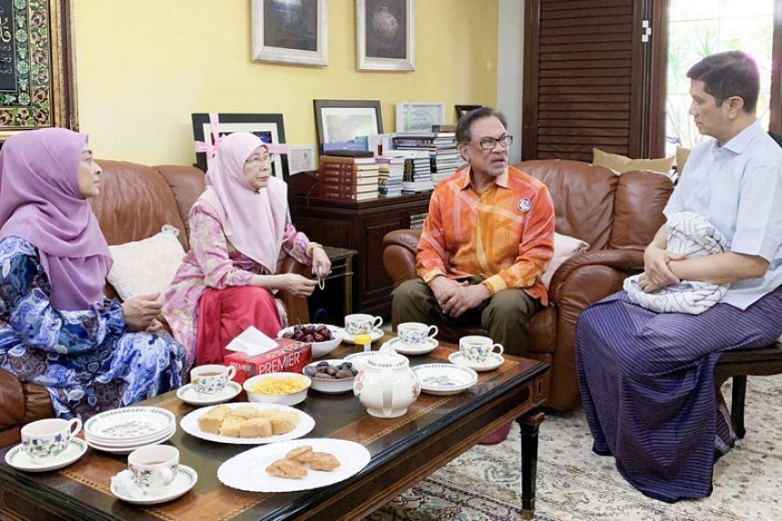 Parti Keadilan Rakyat president Anwar Ibrahim and his wife Wan Azizah Wan Ismail visit Malaysian Economic Affairs Minister Azmin Ali, while Datuk Seri Azmin's wife Shamsidar Taharin looks on, on Feb 6, 2019.