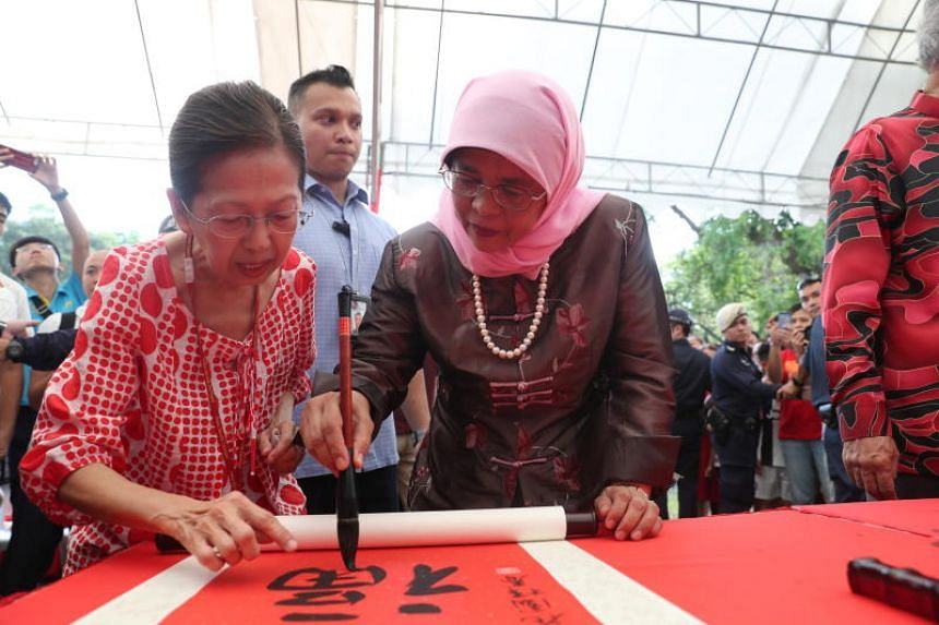 President Halimah Yacob participates in a Chinese calligraphy painting activity during the Istana open house on Feb 6, 2019.