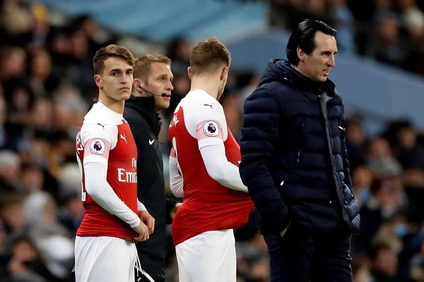 Arsenal's Aaron Ramsey and Denis Suarez alongside manager Unai Emery.