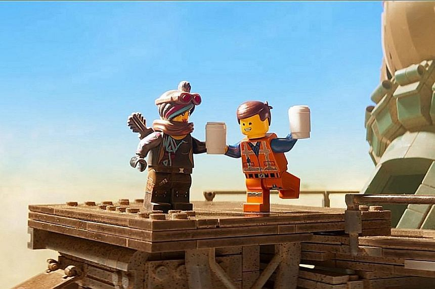 Actor Chris Pratt (above with co-star Tiffany Haddish) reprises his role as Emmet in The Lego Movie 2 (top).