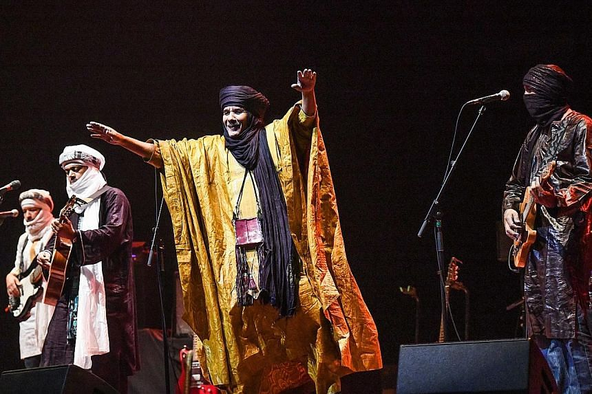 Ms Dany Inthaxoum (above) is the director at Figure8 Agency, which brought acts such as Tinariwen (right), a Grammy Award-winning group of Tuareg musicians from the Sahara Desert, to Singapore.