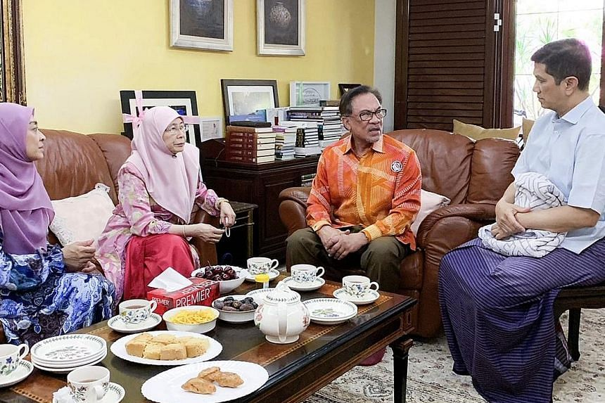 Malaysia's Deputy Prime Minister Wan Azizah Wan Ismail and her husband, PKR president Anwar Ibrahim (both centre), visiting Economic Affairs Minister Azmin Ali, who is convalescing at home from gall bladder surgery, yesterday. With them is Mr Azmin's