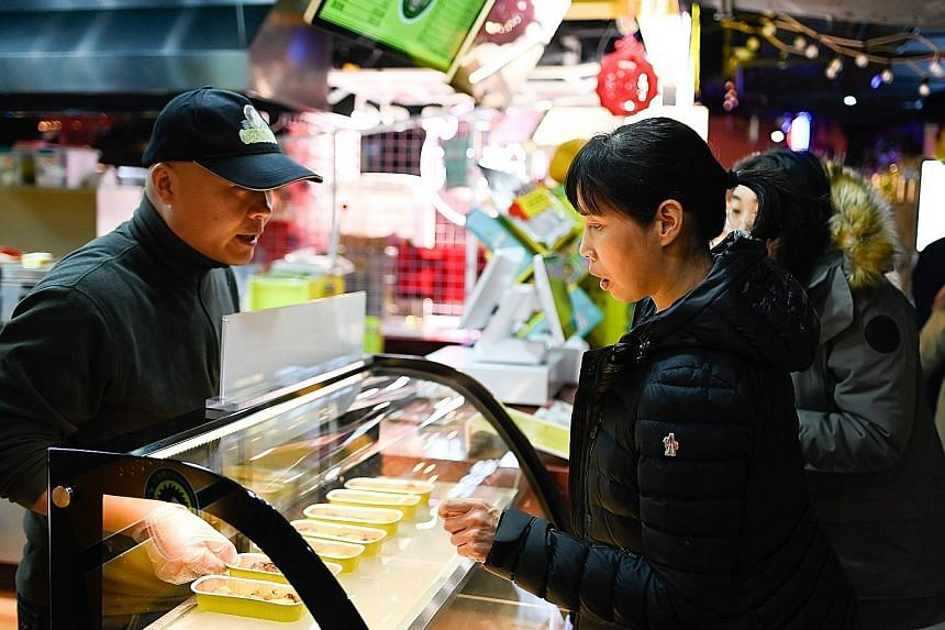 Customers at the Little Fruit Captain durian stall in Beijing last month.