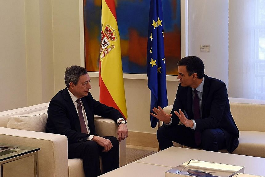 Spanish Prime Minister Pedro Sanchez (at right) meeting European Central Bank president Mario Draghi in Madrid on Monday. From the start of this year, Mr Draghi has been warning about the economic risks facing the euro area.