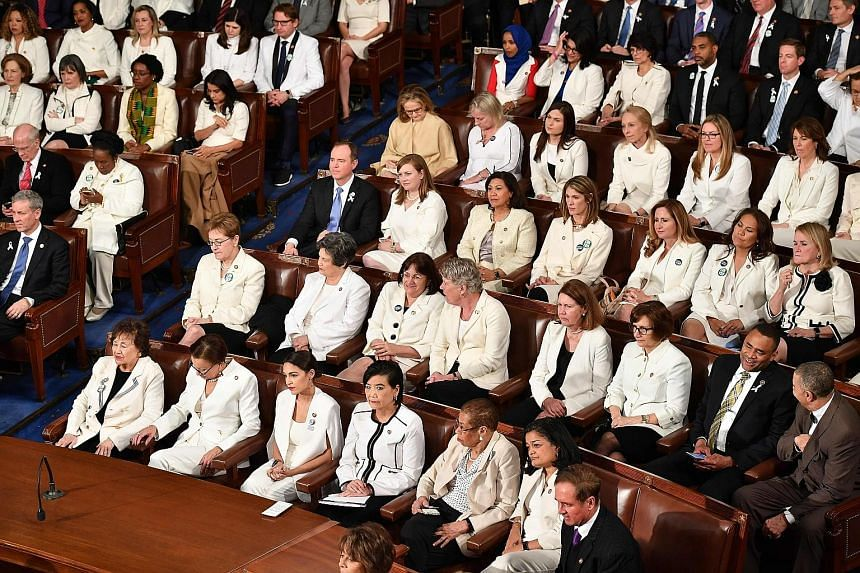Women lawmakers dressed in white at President Donald Trump's State of the Union address on Tuesday in Washington. Mr Trump's ex-housekeeper Victorina Morales was a guest. United States First Lady Melania Trump (third from left) at the House gallery t