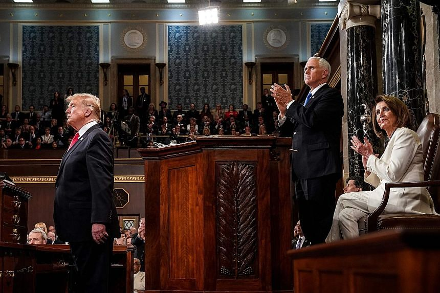 United States President Donald Trump delivering the State of the Union address at the US Capitol in Washington on Tuesday. With him are Vice-President Mike Pence and Speaker of the House Nancy Pelosi.