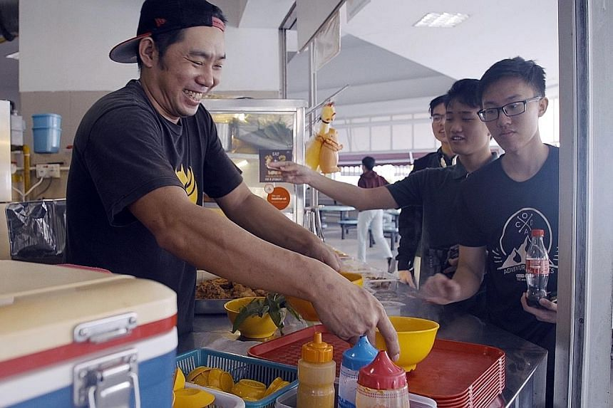 """Mr Vince Ang, 41, used to run a yong tau foo stall in the TPJC canteen. His stall was beside his aunt's stall, which sold ban mian. Tampines Junior College's """"last assembly"""" on Dec 8 last year that was attended by more than 300 former staff and stude"""
