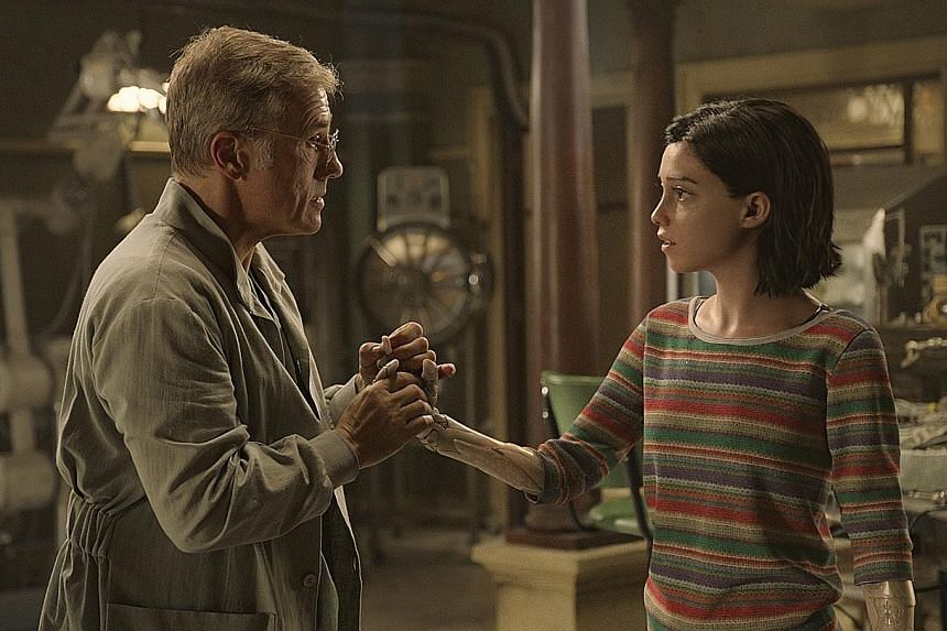 Based on the manga series created by Yukito Kishiro, Alita: Battle Angel stars Christoph Waltz (left) as a scientist who revives Rosa Salazar's cyborg Alita (right).
