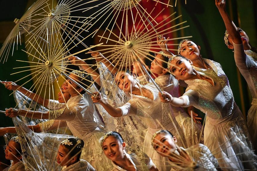 National Taiwan University of Arts dancers performing an item called In The Cool Breeze at the River Hongbao yesterday. An Istana open house, which drew more than 23,000 visitors, added to the Chinese New Year festivities.