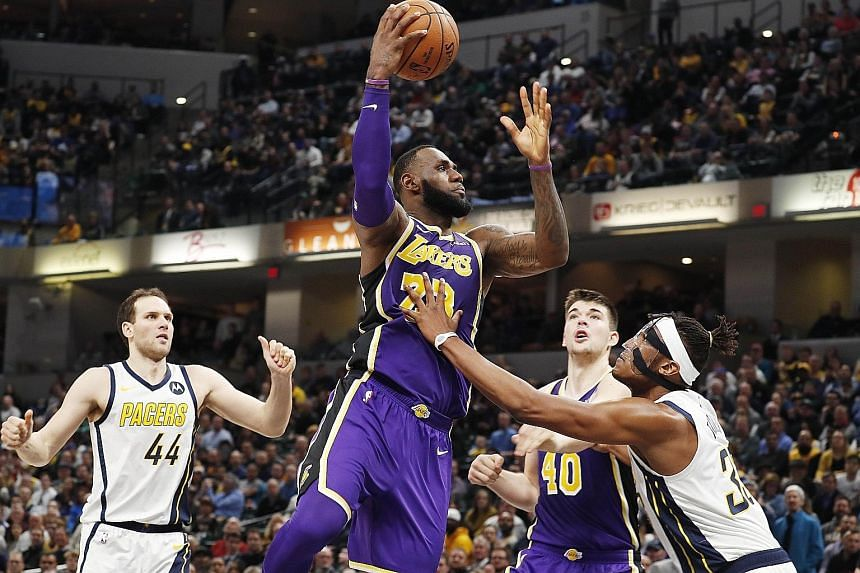 Lakers forward LeBron James taking a shot, as Indiana Pacers centre Myles Turner goes for the block at the Bankers Life Fieldhouse in Indianapolis during the hosts' 136-94 win.