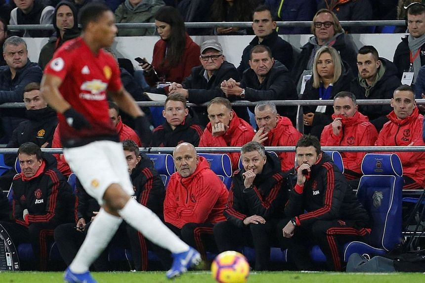 Manchester United interim manager Ole Gunnar Solskjaer, with assistant coaches Mike Phelan (left) and Michael Carrick, watching Anthony Martial in action during his first match in charge against Cardiff City in December. The 45-year-old Norwegian has