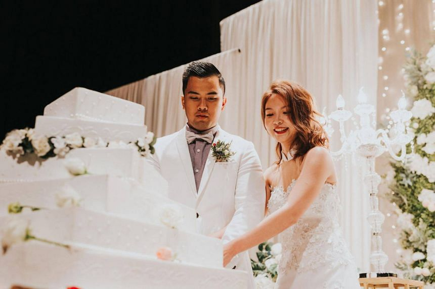 Ms Lexy Leong (right) wore a white wedding gown custom-made by bridal boutique Alerisa when she married her husband Muhd Shazwan in Oct 2018.