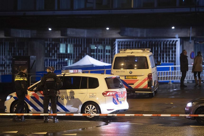 Dutch police officers standing guard at the site of a shooting at De Nederlandse Bank in Amsterdam, the Netherlands, on Feb 6, 2019.