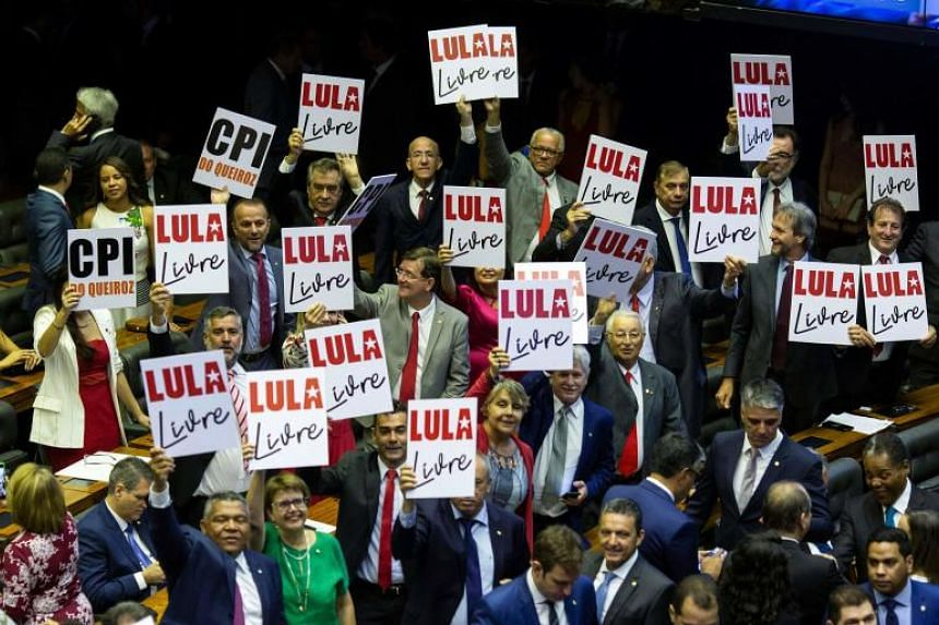 "Opposition deputies hold posters reading ""Free Lula"" in support of Brazilian imprisoned former president Luiz Inacio Lula Da Silva, during the inauguration of the new legislature at the National Congress in Brasilia, on Feb 1, 2019."
