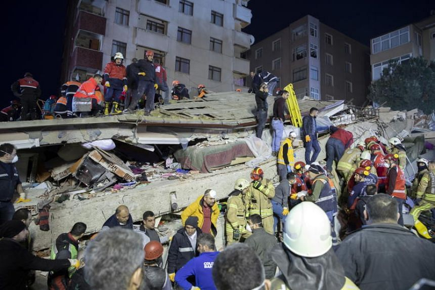 Rescuers work at the site of a collapsed building in the Kartal district of Istanbul, Turkey, on Feb 6, 2019.
