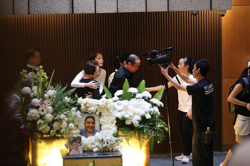 Mr Ben Goi's parents and wife Tracy Lee paying their last respects.