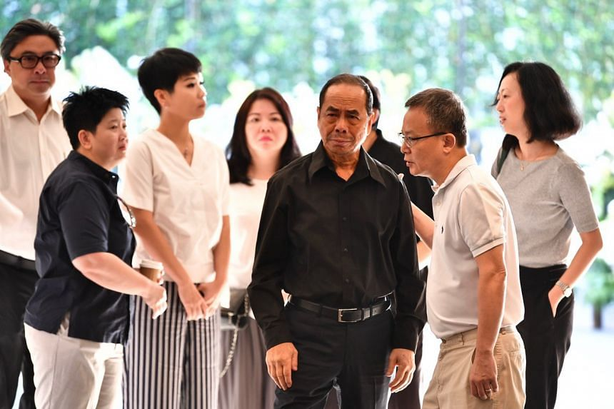 Mr Ben Goi's father, Mr Sam Goi (centre, in black), and friends of the family at the funeral service held on Thursday (Feb 7).