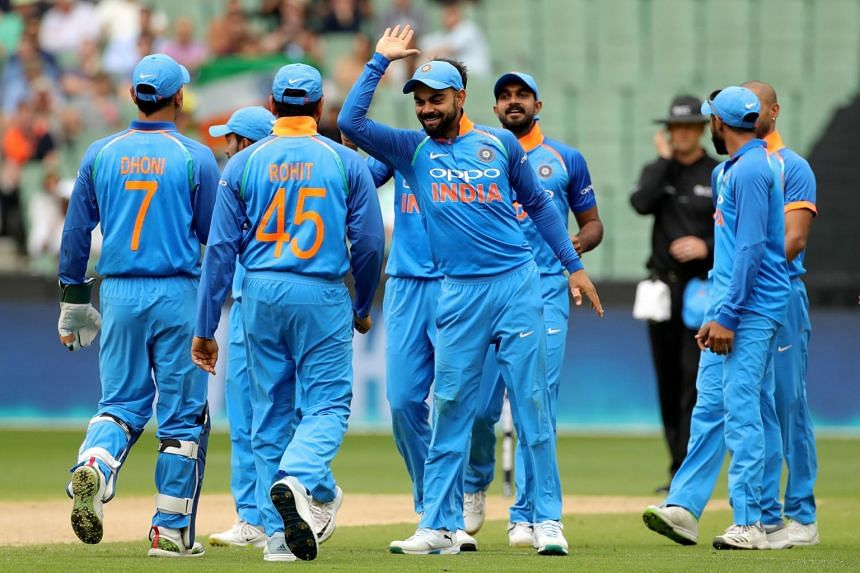 India's captain Virat Kohli celebrates with his teammates after the dismissal of Australia's Aaron Finch off the bowling of Bhuvneshwar Kumar during the third one-day international match between Australia and India, on Jan 18, 2019.