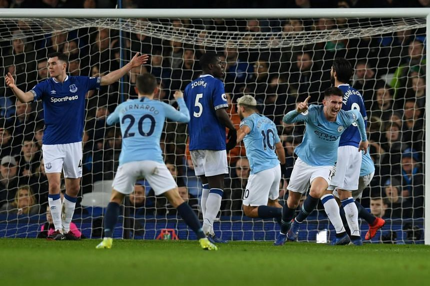 Manchester City's French defender Aymeric Laporte celebrates after scoring the opening goal during the English Premier League football match between Everton and Manchester City, north west England, on Feb 6, 2019.
