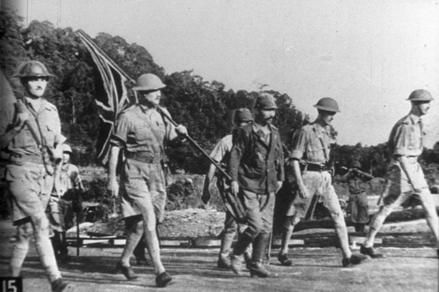 Lieutenant-General Arthur Ernest Percival (right) and other British officers on the way to Ford Factory in Bukit Timah on Feb 15, 1942, to surrender, marking the start of the Japanese Occupation.