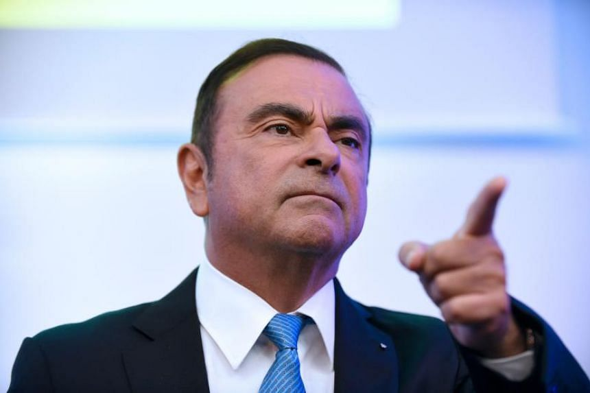 Carlos Ghosn gestures during a press confrence in Paris, on Oct 6, 2017.