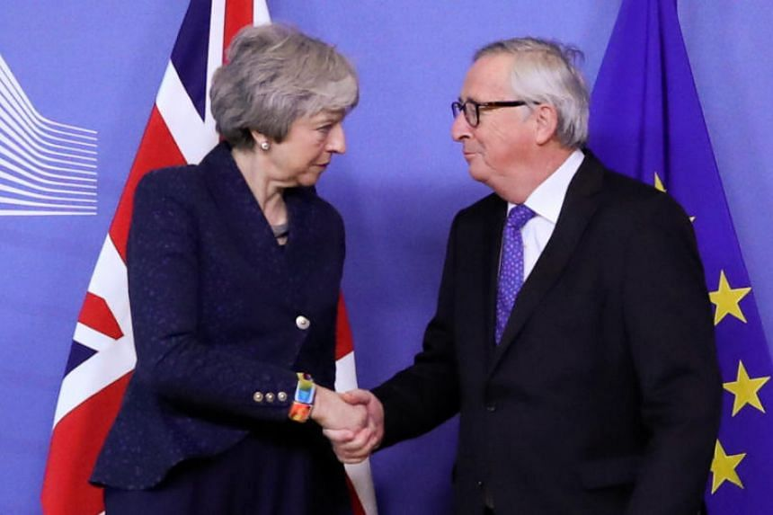 EU leader Jean-Claude Juncker with British Prime Minister Theresa May at the European Commission headquarters in Brussels on Feb 7, 2019. The pair will hold further talks on Britain's withdrawal from the bloc before the end of the month.