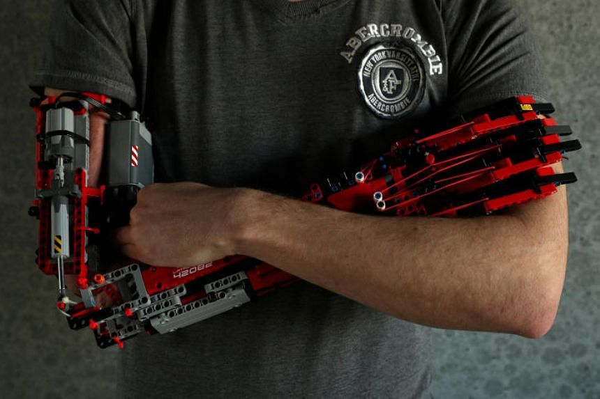 David Aguliar poses with his prosthetic arm built with Lego pieces during an interview in Sant Cugat del Valles, near Barcelona, on Feb 4, 2019.