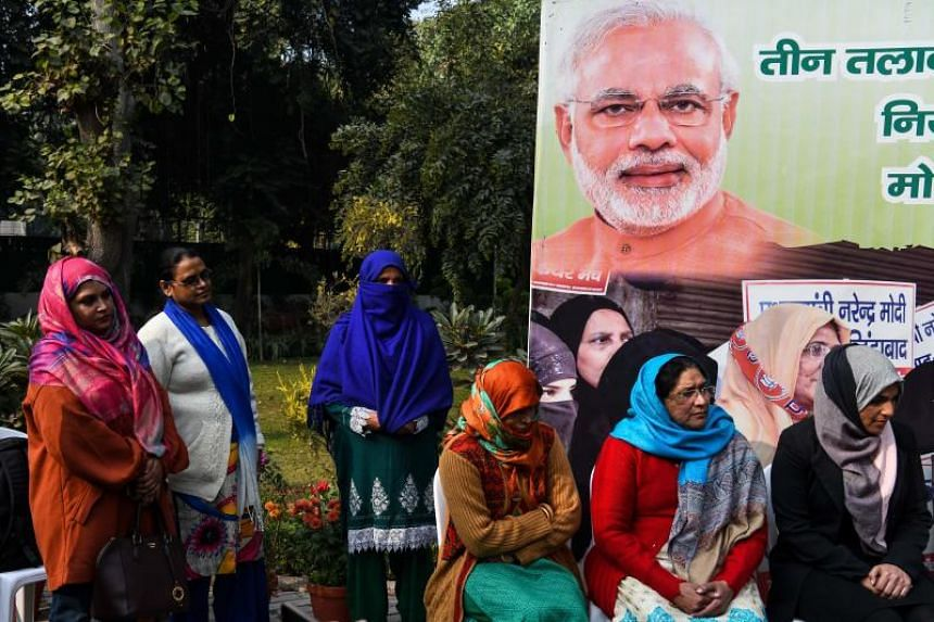 "Indian Muslim women celebrate the passing of a Bill against the Islamic practice of ""instant divorce"" at a press conference in New Delhi on Dec 28, 2018."