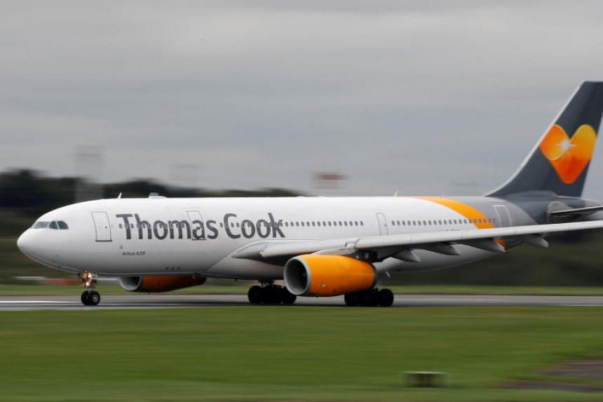 Thomas Cook said it had made progress in managing its cost base but that flight bookings for this summer reflected consumer uncertainty, especially in Britain.