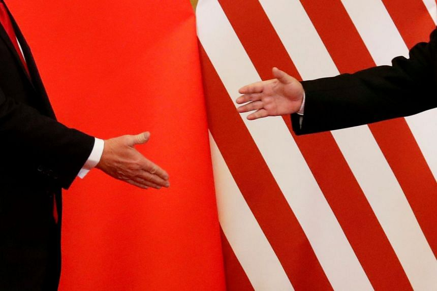 Trump and Xi shake hands after making joint statements in Beijing, in November 2017.